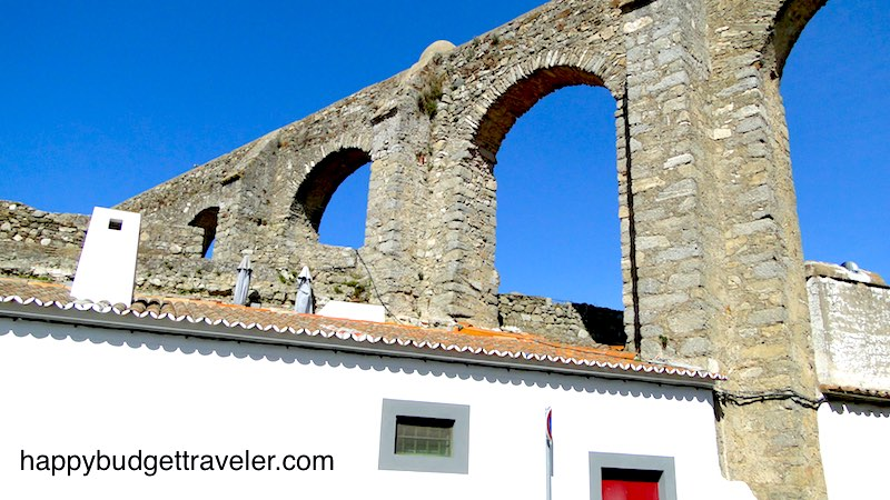 Houses intertwined in the aqueduct, Évora-Portugal.
